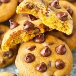 A Plate of Pumpkin Chocolate Chip Cookies with One Cookie Broken in Half on Top