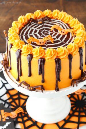 Spiderweb Chocolate Cake with Vanilla Frosting on white cake stand