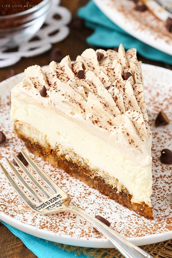"A slice of tiramisu cheesecake with a fork that says ""dessert first"" on it"