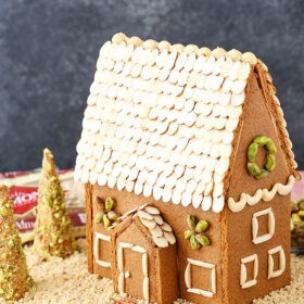 A homemade gingerbread house decorated with nuts