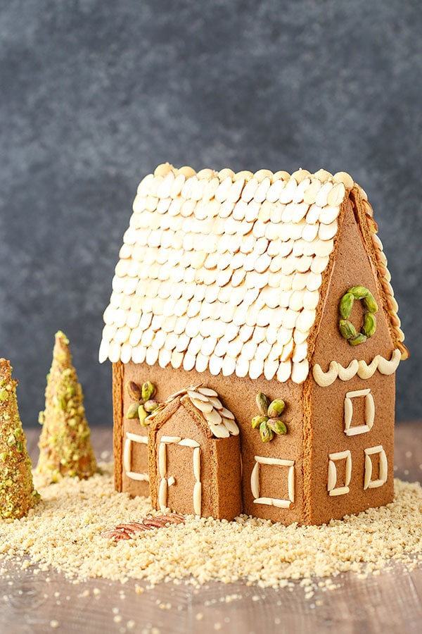 A gingerbread house made form scratch out of cookies and nuts