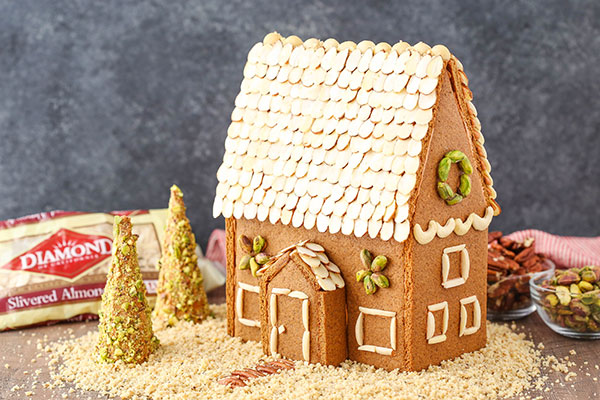 Homemade Gingerbread House surrounded by nuts