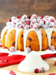 Cranberry bundt cake with sparkling cranberries and white chocolate ganache on top