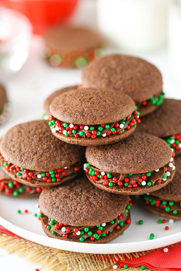 Double Chocolate Cookies piled on a white plate with green and red sprinkles