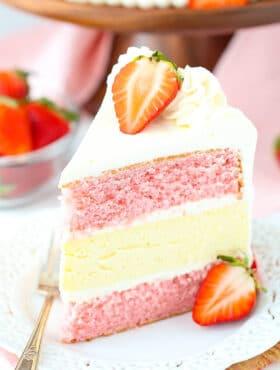 slice of Strawberries and Cream Cheesecake Cake