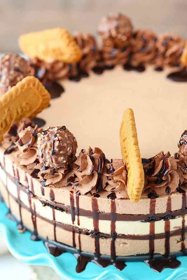 Close up of a Icebox Cake that is topped with Biscoff cookies, chocolate whipped cream and Ferrero Rocher
