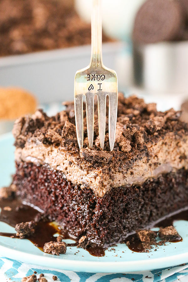 Oreo Chocolate Poke Cake - an easy homemade chocolate cake covered in more chocolate and Oreo whipped cream! So good!