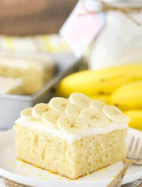 A Slice of Banana Cake with Cream Cheese Frosting on a Plate