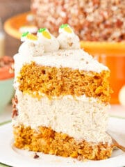 slice of Carrot Cake Cheesecake Cake