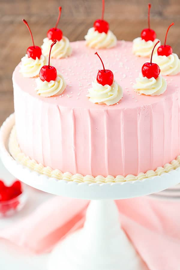 Cherry Almond Layer Cake - a light almond cake, cherry frosting and bits of cherry between the cake layers! So good!