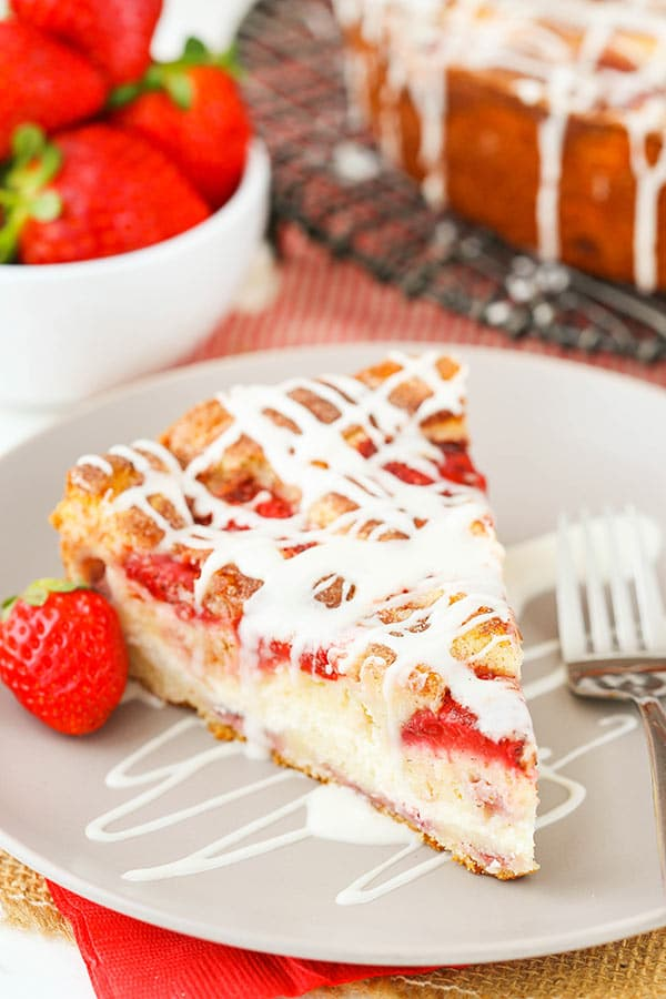 Strawberry Snack Cake - moist cake full of strawberries, cream cheese filling and cinnamon sugar! Great for breakfast or a snack!