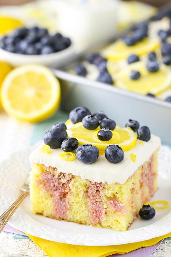 Lemon Blueberry Poke Cake - a light lemon yellow cake mix soaked with blueberry puree, lemon and sweetened condensed milk! Easy to make and so good!
