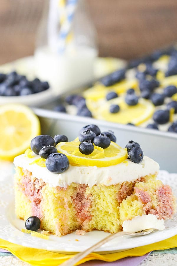 Serving of Lemon Blueberry Poke Cake on plate