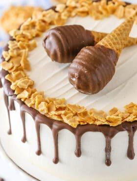 Peanut Butter Chocolate Ice Cream Cone Cake - peanut butter cake and vanilla ice cream studded with chocolate covered cone pieces and peanut butter!