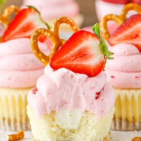 Strawberry Pretzel Salad Cupcakes - modeled after the classic dessert with a pretzel crust, cream filling and strawberry JELLO frosting!