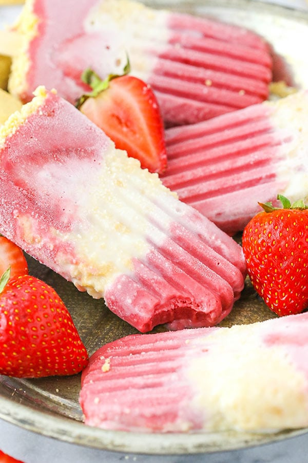 Strawberry Shortcake Popsicles - layers of delicious strawberry and milky vanilla filled with shortbread, its truly like eating strawberry shortcake in popsicle form