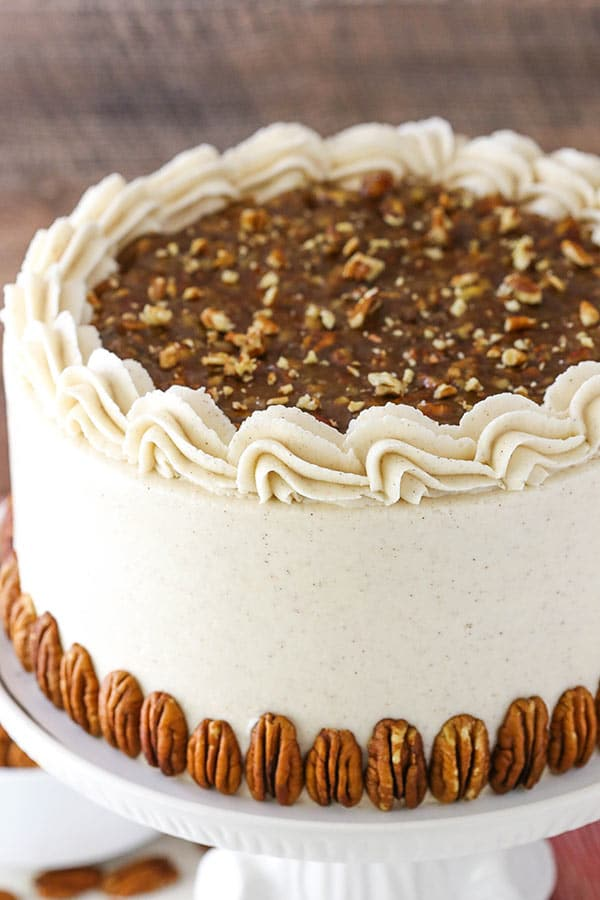 Pecan Pie Layer Cake - layers of homemade pecan pie filling, moist brown sugar cake and cinnamon frosting!