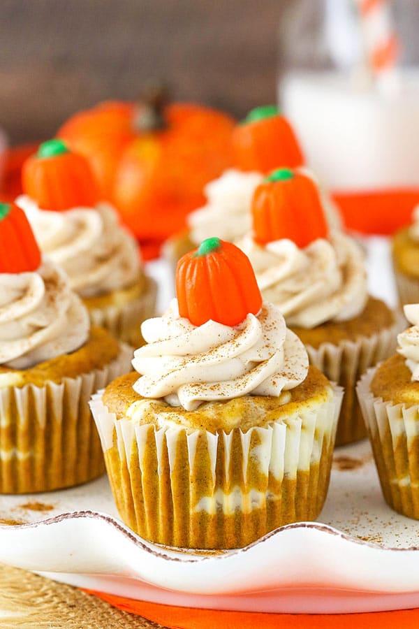 Pumpkin Cheesecake Swirl Cupcakes - layers of pumpkin cupcake and cheesecake! So good!