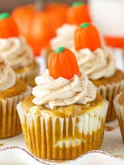 Pumpkin Cheesecake Swirl Cupcakes - layers of pumpkin cupcake and cheesecake! So good!
