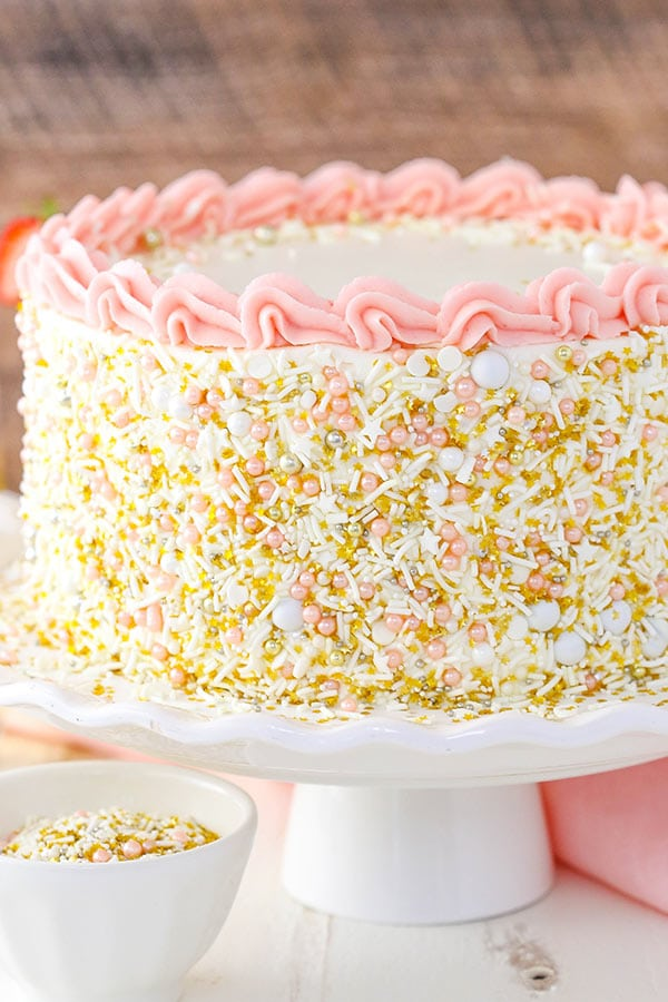Strawberry Champagne Layer Cake - layers of moist champagne cake with fresh strawberry frosting! Perfect for New Years Eve!