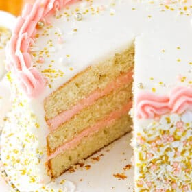 Strawberry Champagne Layer Cake with slice removed