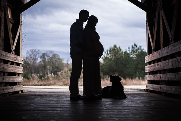 A Silhouette of me, my Husband and our Dog in a Covered Bridge