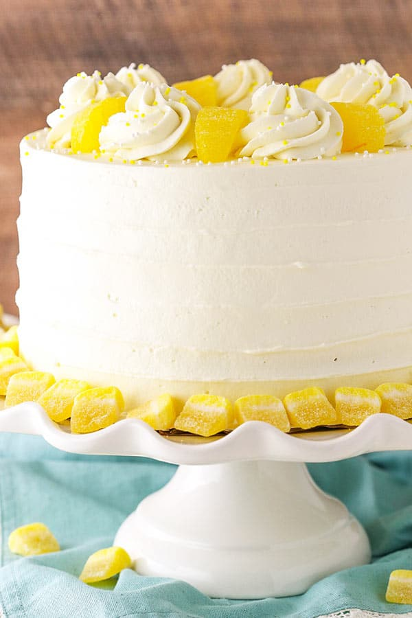 Lemon Mascarpone Layer Cake - a light lemon cake with lemon curd filling and whipped mascarpone frosting! Delicious!