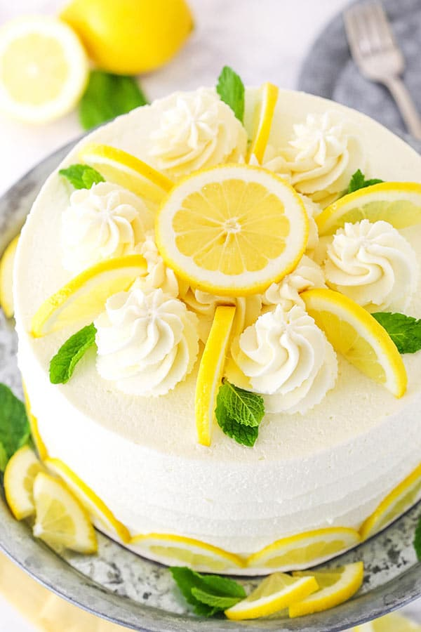 overhead shot of lemon mascarpone cake with lemon slices and mint leaves