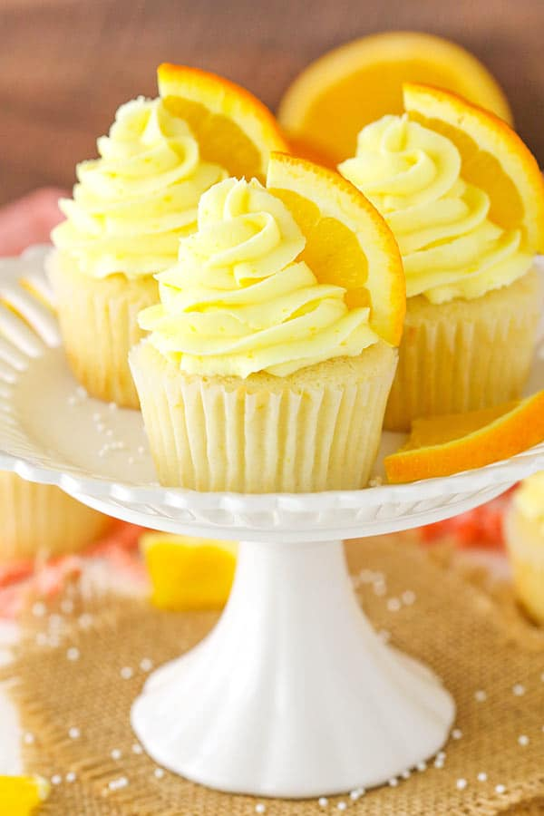 Orange Cream Cupcakes displayed on white stand