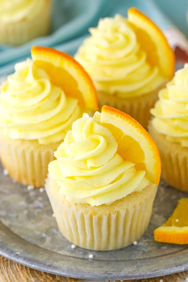 close up of decorated Orange Cream Cupcakes