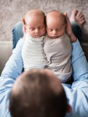 My Husband Holding Ashton and Brooks on His Lap While They're Swaddled