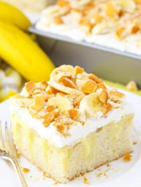 slice of Banana Pudding Poke Cake on plate