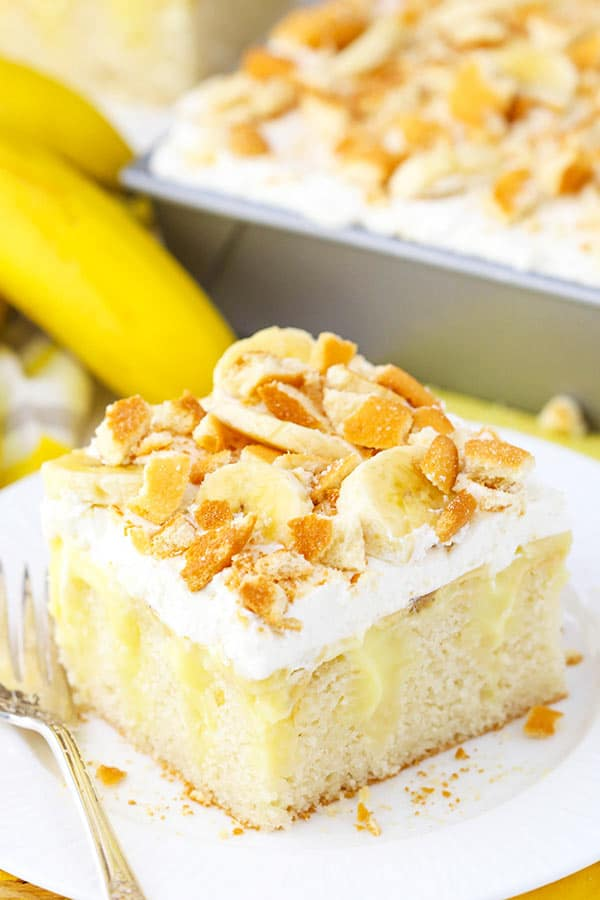 Banana Pudding Poke Cake - moist vanilla cake, homemade banana pudding, whipped cream, banana and vanilla wafers!