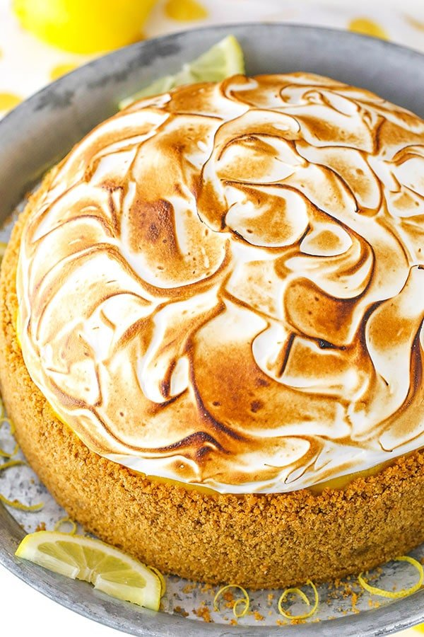 Lemon Meringue Cheesecake! A graham cracker crust, creamy cheesecake, tart lemon topping and toasted meringue!