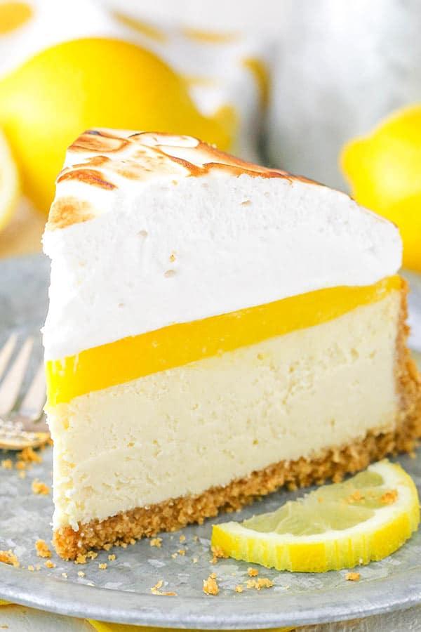 Lemon Meringue Cheesecake! A graham cracker crust, creamy cheesecake, tart lemon topping and toasted meringue!