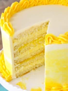 Lemon Bavarian Cake - layers of soft lemon cake, lemon bavarian cream and lemon curd covered in lemon buttercream!