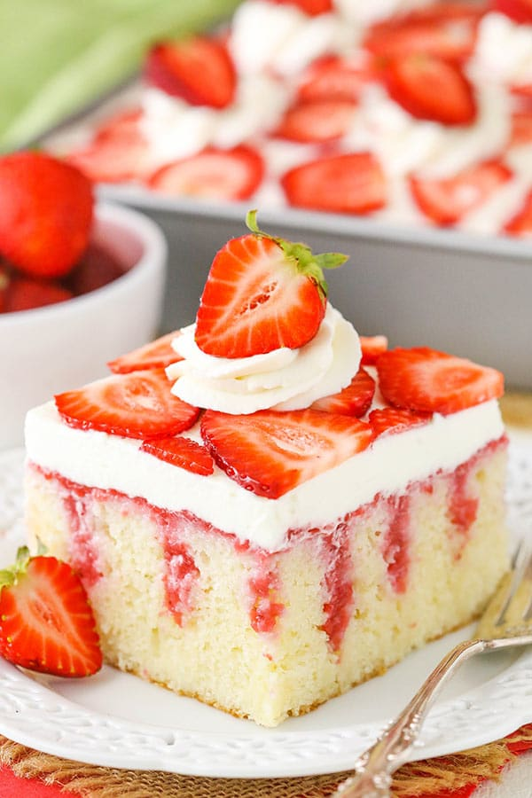 This Strawberry Poke Cake is a from-scratch vanilla cake covered with sweetened condensed milk, fresh strawberry sauce and cream cheese whipped cream!