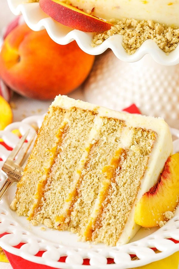 Brown Sugar Layer Cake with Peach Filling - layers of moist brown sugar cake, fresh peach filling and peach mascarpone frosting!