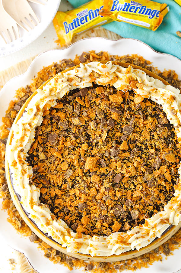 is Butterfinger Cheesecake is a thick and creamy peanut butter cheesecake filled with chopped Butterfingers in an Oreo crust!