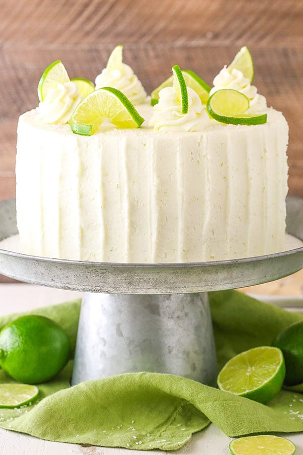 This Margarita Cake is flavored with lime and plenty of tequila for a moist and tender layer cake that is so full of margarita flavor!
