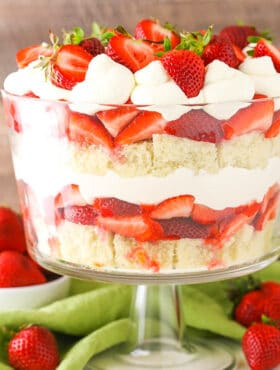 This Strawberry Shortcake Trifle is simple to make with layers of moist vanilla cake, fresh strawberries, strawberry sauce and fresh whipped cream!