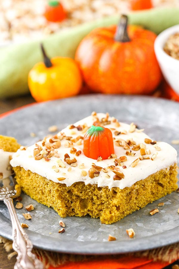 This Pumpkin Sheet Cake is moist, fluffy and covered with a cinnamon cream cheese frosting!