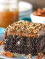 Turtle Chocolate Poke Cake - completely from scratch, moist chocolate cake soaked with caramel sauced topped with more chocolate, caramel and pecans!