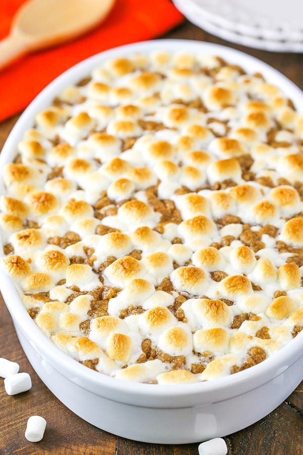 Sweet Potato Casserole with marshmallows and streusel topping in a white baking dish