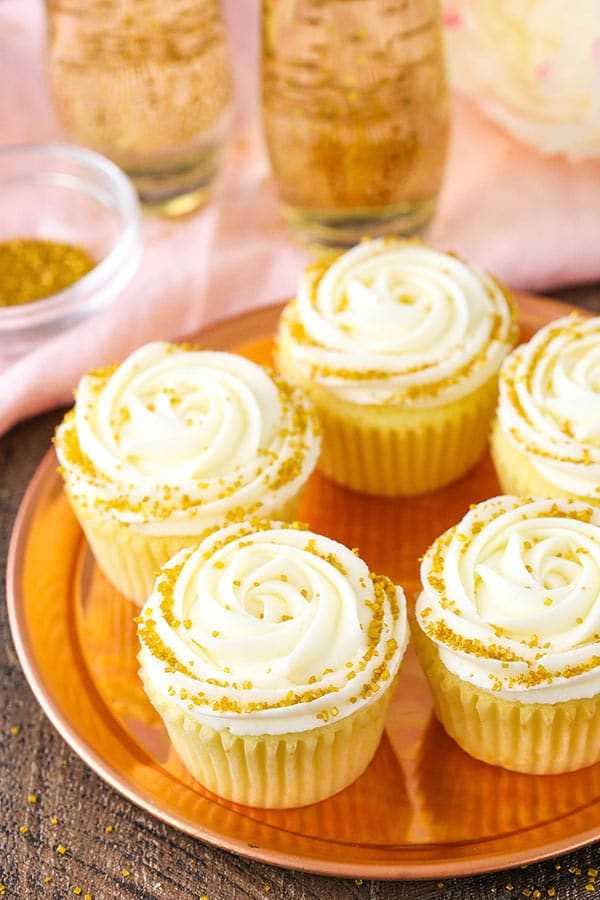 Moist Champagne Cupcakes with champagne truffle filling and champagne buttercream!