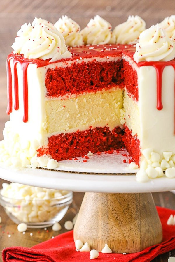 This Red Velvet Cheesecake Cake is made with layers of moist red velvet cake and thick and creamy cheesecake! If you've ever had the cheesecake by the same name at The Cheesecake Factory and loved it, this is the perfect recipe to make at home!