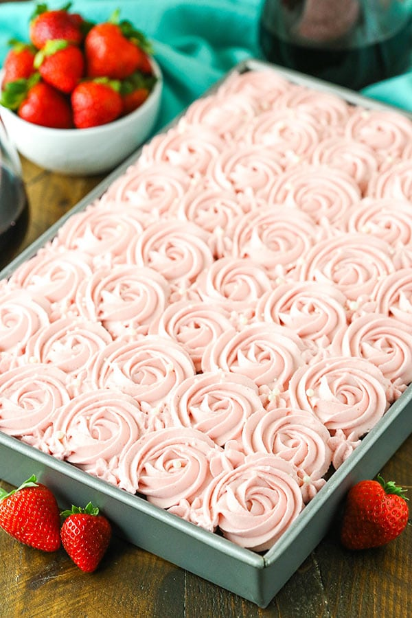 Red Wine Chocolate Poke Cake - moist chocolate cake made with red wine, soaked with more chocolate and red wine, topped with fresh strawberry whipped cream!