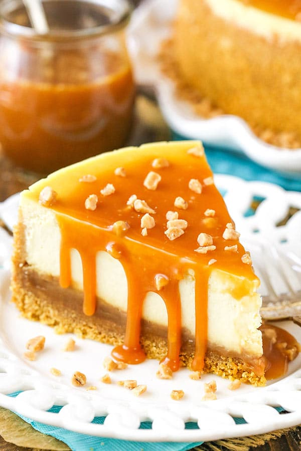 A slice of cheesecake covered with caramel topping