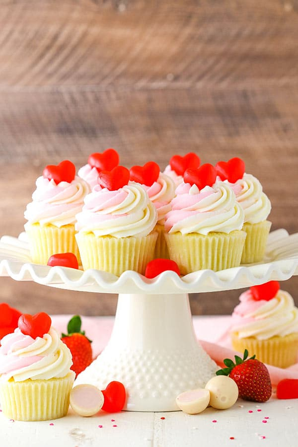 These Strawberry Truffle Cupcakes are moist vanilla cupcakes filled with strawberry truffle filling, topped with white chocolate buttercream!