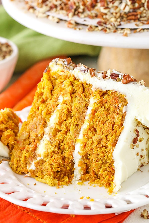This Carrot Cake is wonderfully moist, tender and easy to make! It's covered in cream cheese frosting for a perfect, classic cake!